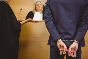 criminal-defense-handcuffed-infront-of-judge